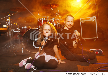 boy and girl singing in recording studio 42475015
