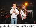 boy and girl singing in recording studio 42475023