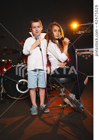 boy and girl singing in recording studio 42475026