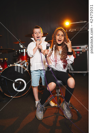 boy and girl singing in recording studio 42475031