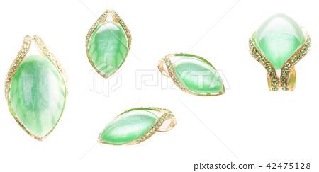 Vintage green golden ruby brooch on white background 42475128