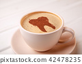 Cup of coffee with tooth on foam. Coffee spoils 42478235