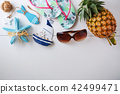 Summer beach accessories on white wood background 42499471