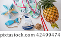 Summer beach vacation items on white wood flat lay 42499474