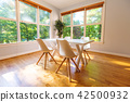 Kitchen dining table and chairs bright interior 42500932