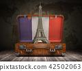 Trip to Paris. Eiffel tower in suitcase 42502063