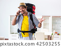Backpacker packing for his trip 42503255