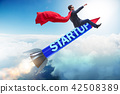 Superhero businessman in start-up concept flying rocket 42508389