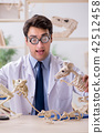 Funny crazy professor studying animal skeletons 42512458
