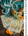 Sewing accessories on wooden background 42518459