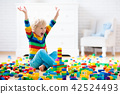 Child playing with toy blocks. Toys for kids. 42524493
