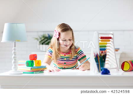 Child with abacus doing homework after school. 42524598