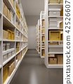 warehouse interior with rows of shelves with boxes 42526607