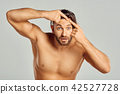 Shocked Man Looking At Pimple On Forehead. 42527728