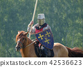 medieval knight with a spear riding a horse 42536623