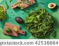 Gren vegetables for salad - lettuce, greens, pea sticks, rosemary, avocado, lime on a wooden cutting 42536664