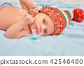 Close up portrait newborn baby lying in bed. 42546460
