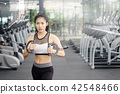 Beautiful woman exercise cable machine in gym. 42548466