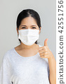 woman with face mask 42551756