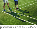 Male and kid silhouettes with rackets 42554572