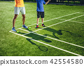 Man and boy shadows locating on court 42554580