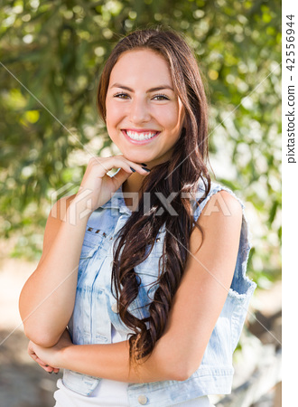 Attractive Smiling Mixed Race Girl Portrait Outdoors 42556944