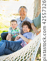 Chinese Grandparents In Hammock with Mix Race Boy 42557326