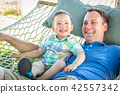family, baby, hammock 42557342