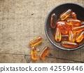 Cod liver oil capsules 42559446