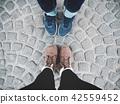 Selfie of friends shoes 42559452
