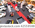 blur of car in show room at motorshow 42559588