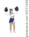 Happy asian cheerleader with pom poms in the air 42571440