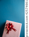 Red gift box on blue background 42574661
