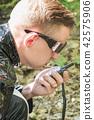 Agent talking on walkie-talkie 42575906