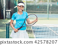 Portrait of a beautiful and competitive Asian tennis player 42578207