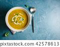 Pumpkin creamy soup in bowl 42578613