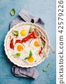 baked eggs tomato 42579226