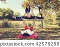 Autumn Park Couple doing acro yoga. Pregnancy 42579299