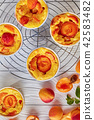 apricot clafoutis in ramekins, top view 42583482