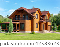 Beautiful luxury big wooden house. Timber cottage villa with with green lawn, garden and blue sky on 42583623
