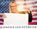 Young Lady Holds House Keys and Blank Sign by Flag 42586148