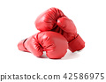 Pair of red leather boxing gloves isolated 42586975
