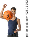 Teenager with sportswear playing basketball. 42591562
