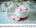 Heart shape marshmallows in white mug on wood 42591838