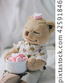 Brown Teddy bear holding pink heart marshmallow 42591846