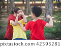 Young asian boy bullied by two boys in park 42593281
