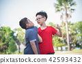 Young asian boy bullying a boy in park 42593432