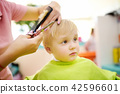 Preschooler boy getting haircut 42596601