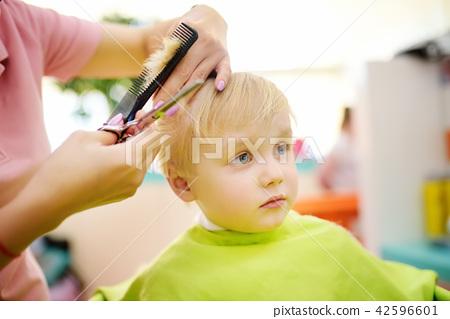 Preschooler boy getting haircut 42596601