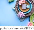 Tableware dish set on blue pastel background 42598353